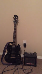 Electric Epiphone SG and micro cube amp
