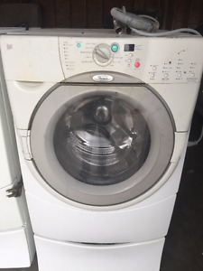 WHIRLPOOL LARGE WASHER AND DRYER WITH PEDESTALS.