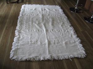 3 white rugs