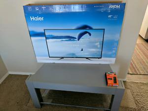 Brand New Haier 40 inch Tv with Stand and Amazon Fire TV