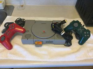 PlayStation complete with 2 controllers and memory card