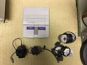Super Nintendo with cords and 2 controllers
