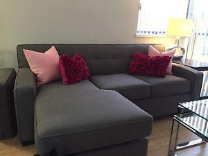 Beautiful, 1-yr-old sectional couch with queen sleeper