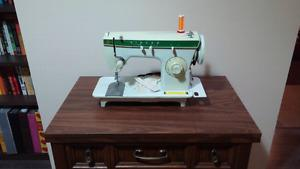 Singer sewing machine with built in table.