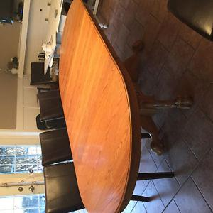 Solid oak dining room table with two inserts