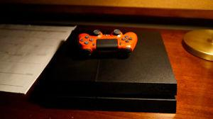 Sony Playstation 4 with Red Game Controller for sale!