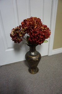 metal vase with flowers