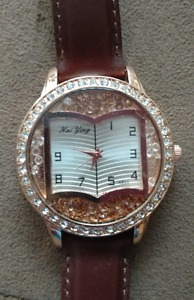 Rosegold toned watch with genuine leather strap