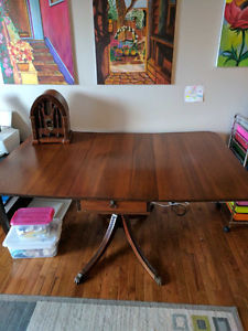 Antique Dinning Table with claw feet.