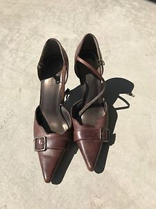 Brown leather heels with a strap