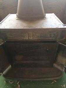 Antique steel wood stove