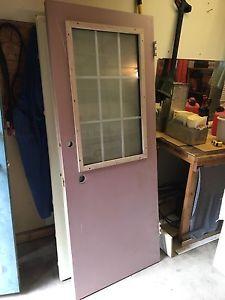 Solid exterior door with window