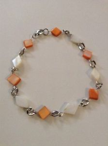 orange and white anklet