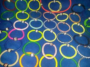91 pc lot faux leather bracelet with magnetic clasps &