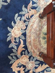 Hand woven wool and silk rug