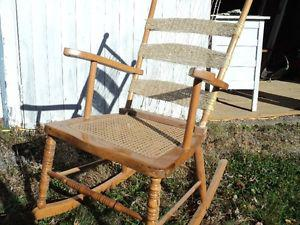 Antique rocking chair with wicker seat.
