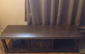Solid wood coffee table with hidden cubby