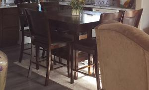Solid wood dining room table with 6 padded chairs