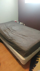 Twin bed with frame and box spring (sheets not included)