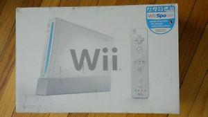 Wii console, controllers, wii fit and games