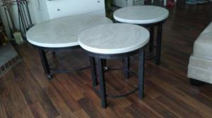 3 round tables. 2 side and 1 large center on wheels.