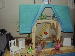 big doll house, barbies and clothes