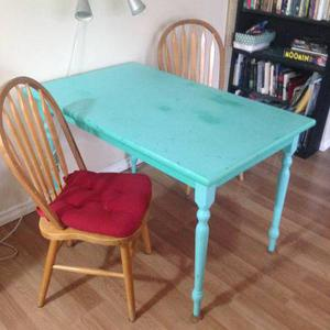 cute antique table and captain's chairs