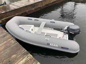 Rigid hull inflatable and 9.9 motor