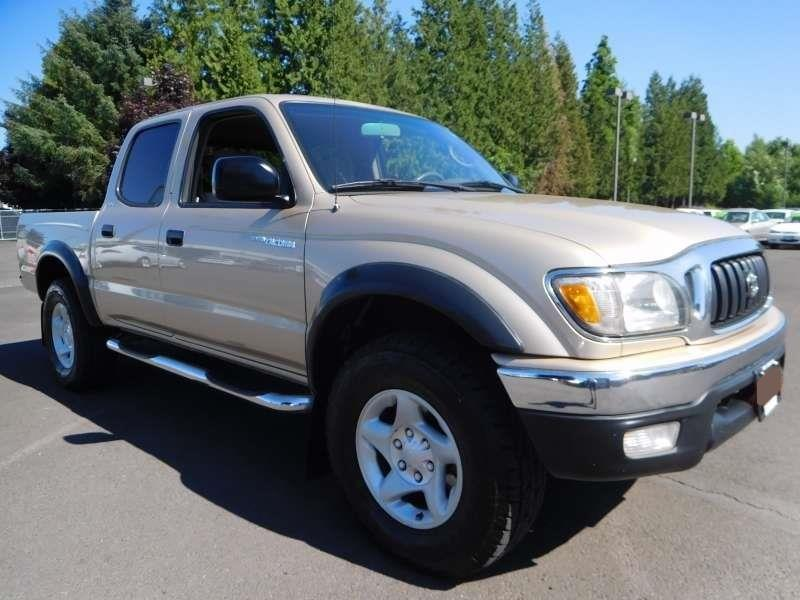 Toyota Tacoma Gold Pickup Truck  Miles