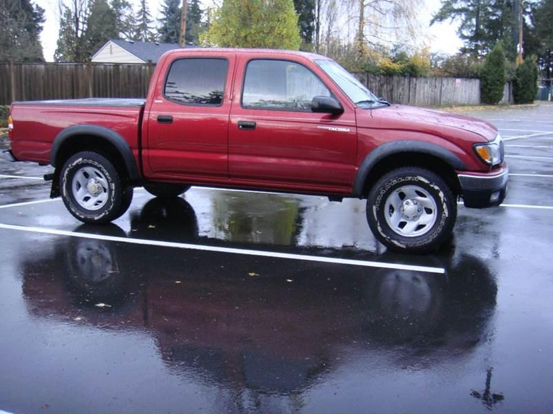 Toyota Tacoma Red Pickup Truck  Miles