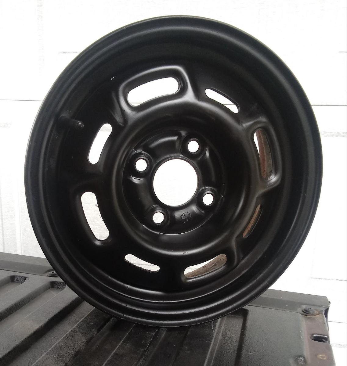 Mustang four hole 14 inch wheels (black)