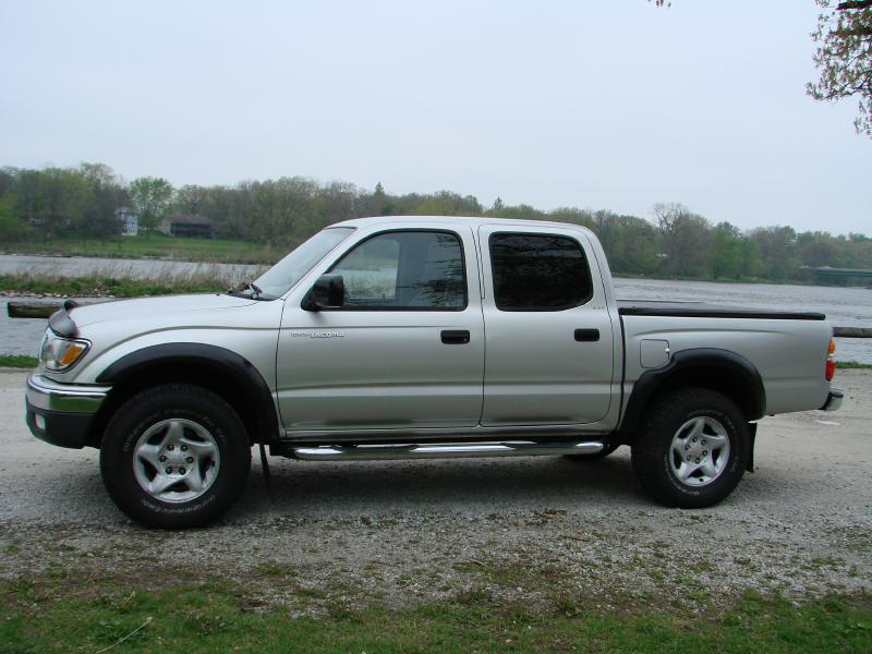 Toyota Tacoma Silver Pickup Truck  Miles