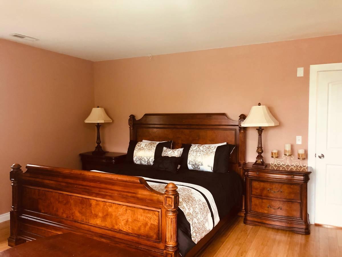 Big luxury furnished bedroom with walking closet
