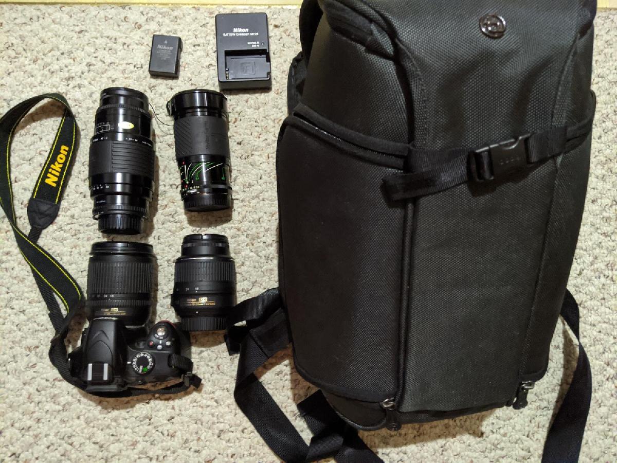Nikon D DSLR camera, multiple lenses, camera backpack